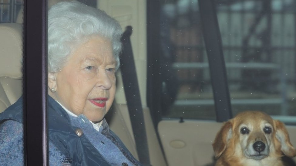 The Queen with one of her corgis, leaving Buckingham Palace