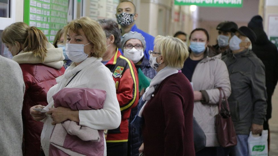 People wait in line at Omsk's City Hospital No 17