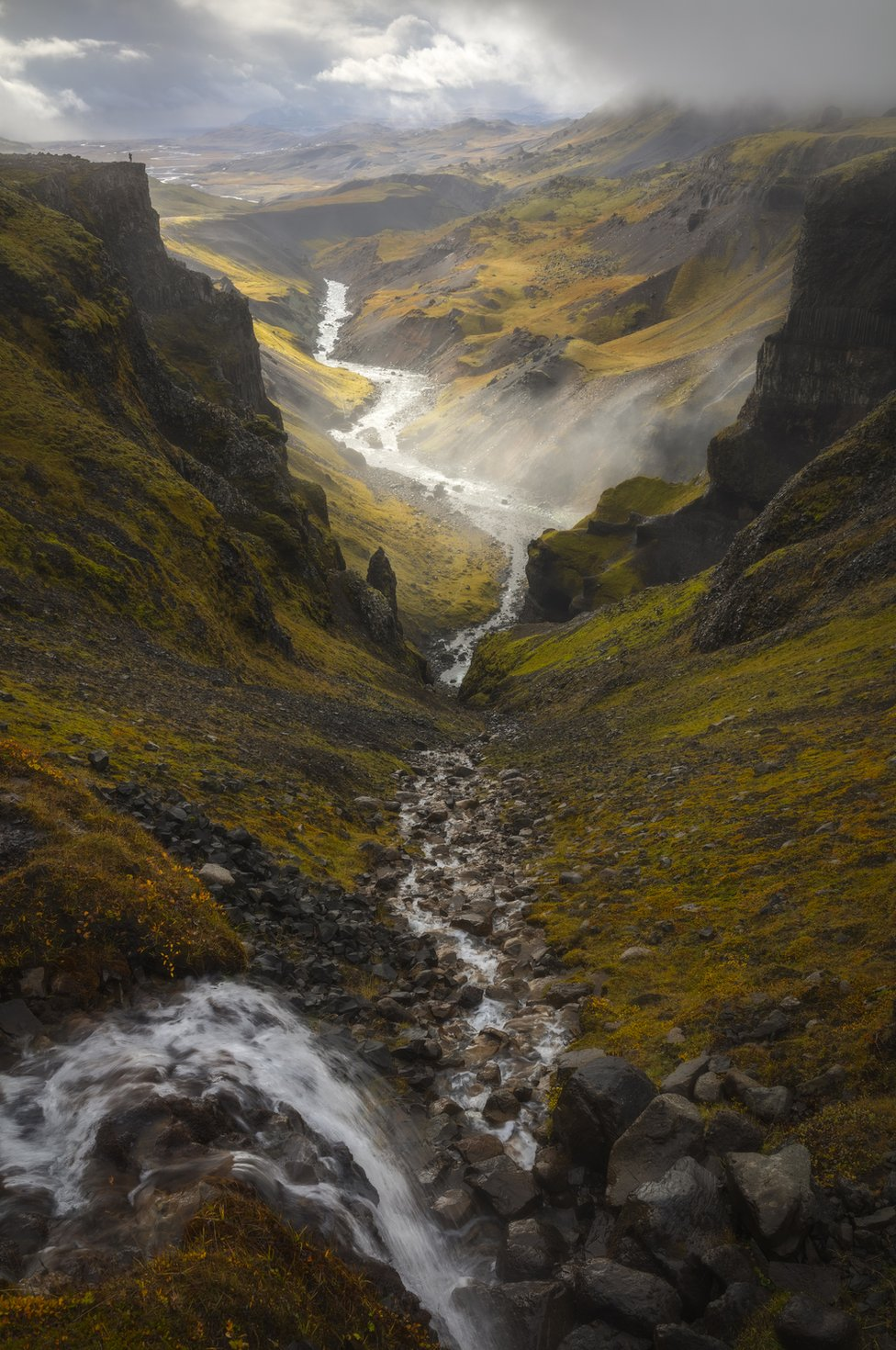 A landscape of a valley and a river at Haifoss, Iceland