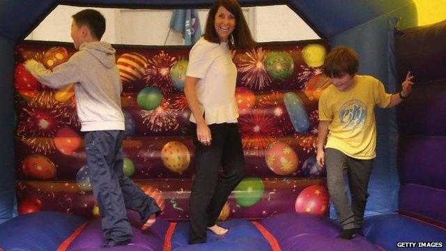 Liz Kendall on a bouncy castle