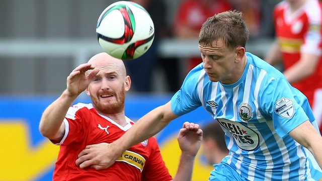 Cliftonville's Ryan Catney in action against Liam Bagnall of Warrenpoint