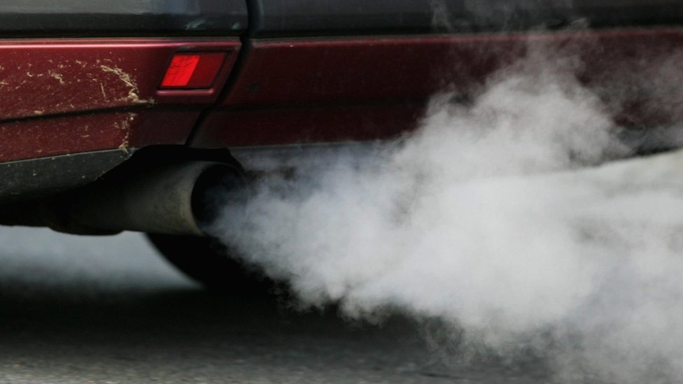 A car exhaust emitting fumes