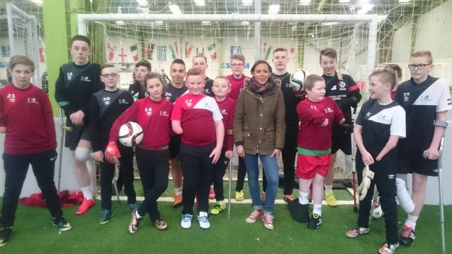 Leah with young amputee football players