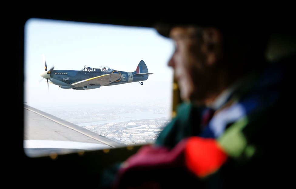 A WWII Spitfire can be seen out of the window of a C47 A Dakota plane, while war veteran Roy Briggs looks on, during Remembrance Sunday commemorations in Dover.