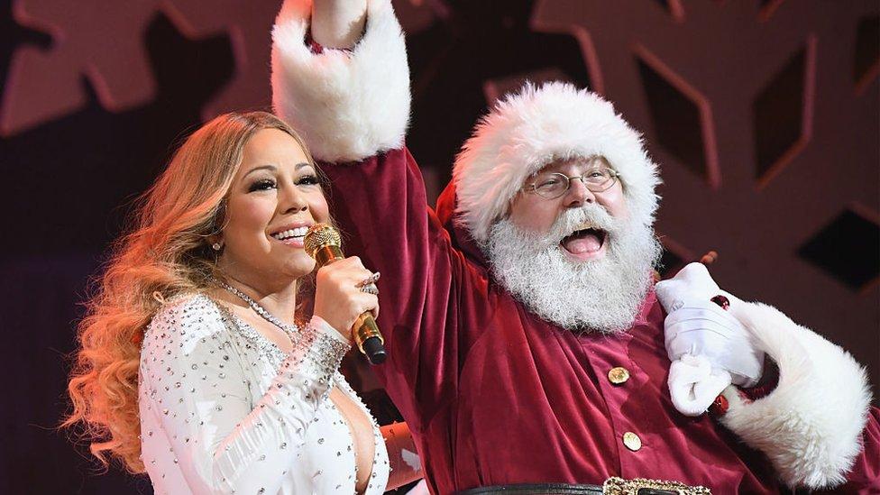 Mariah Carey con Papa Noel.
