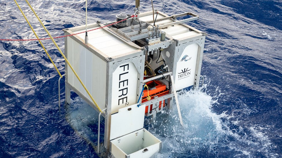 The Limiting Factor LF, an ultra deep-diving submersible, just above the ocean