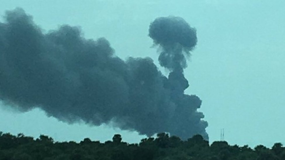 Pictures from the scene show a huge plume of smoke rising above the complex