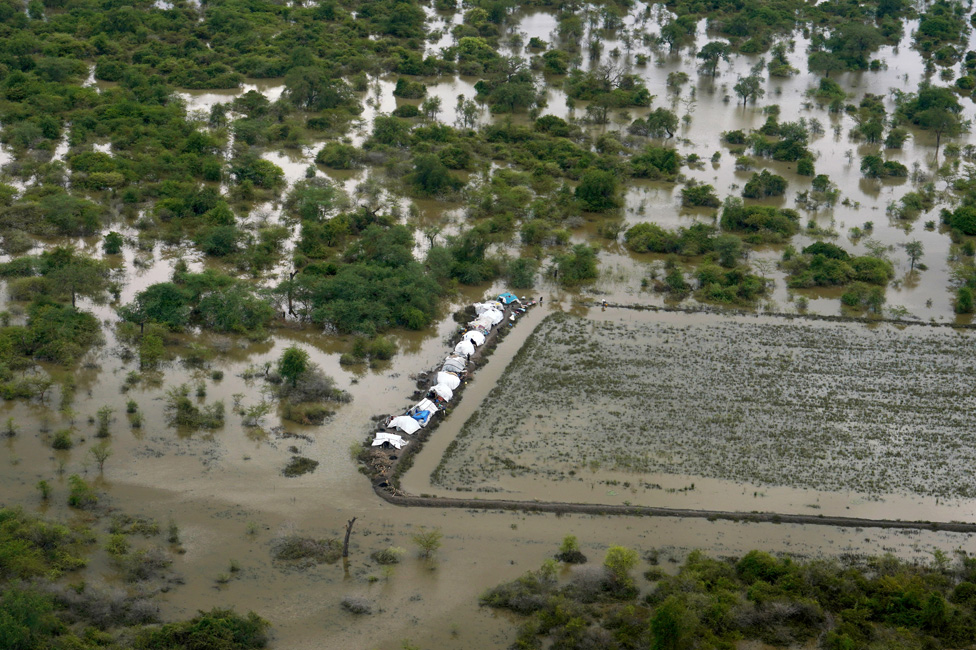 Tents surrounded by water are seen from an aerial view, after heavy rains and floods forced hundreds of thousands of people to leave their homes