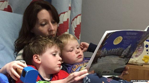 Anna Rafferty, former head of Penguin Digital, reading to her boys