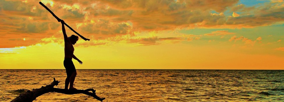 spear fisher at sunset