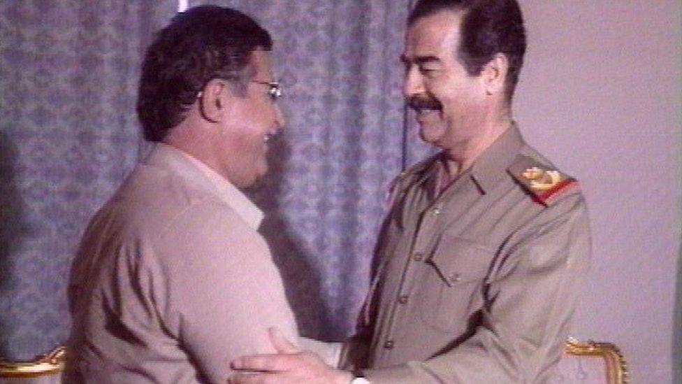 PUK leader Jalal Talabani and Iraqi President Saddam Hussein