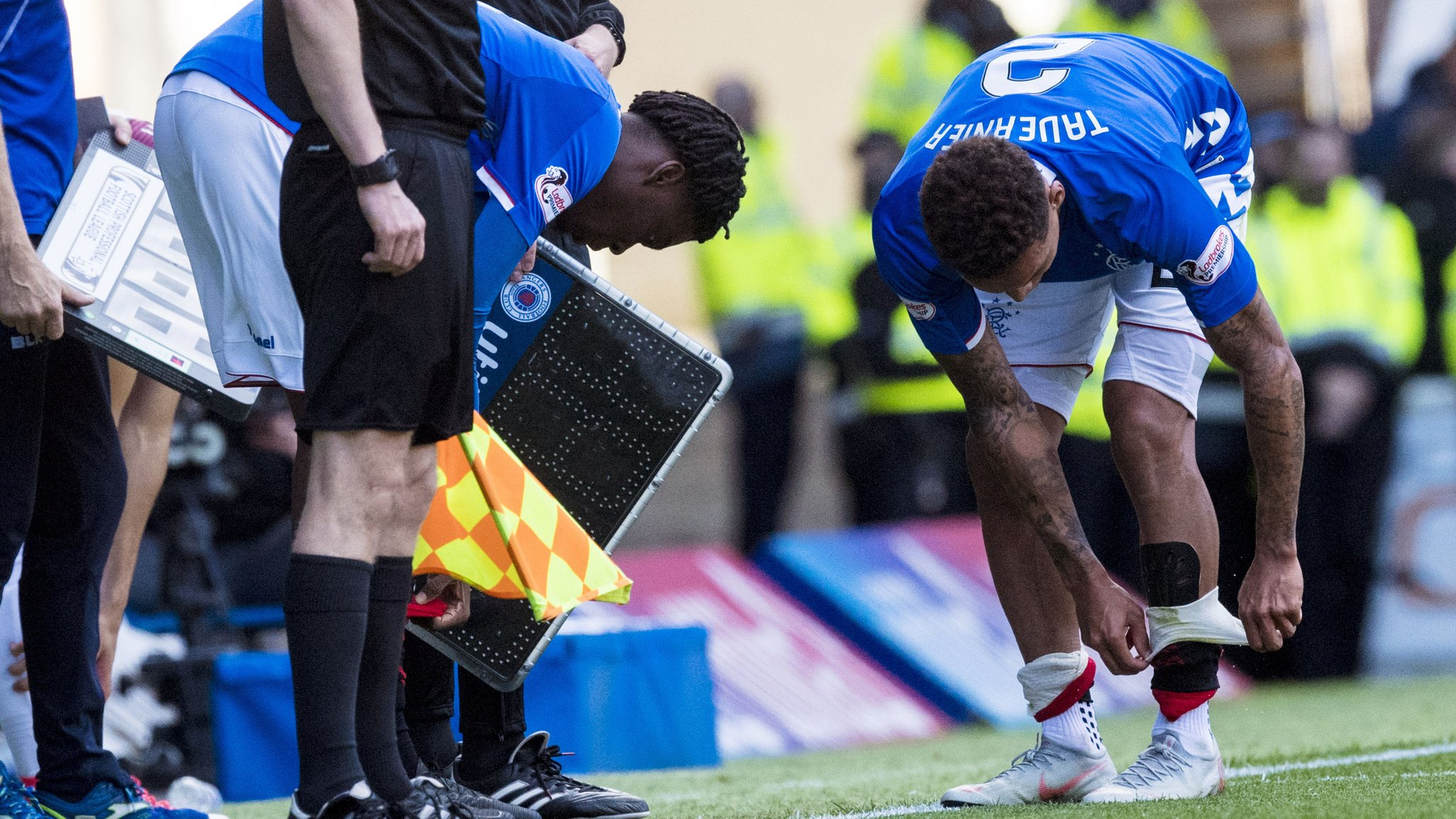 Rangers substitute Ovie Ejaria has to call upon captain James Tavernier's shin pads.