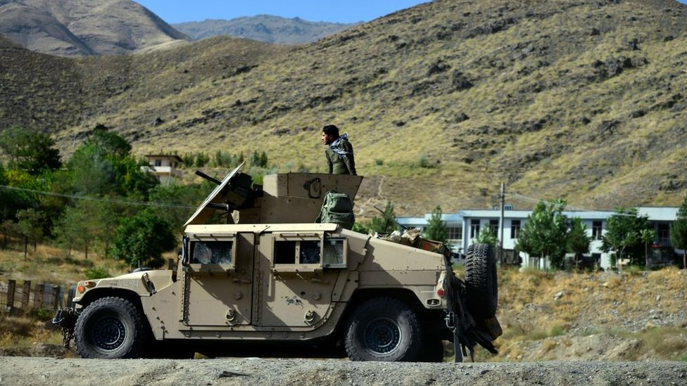 An armoured vehicle patrolling in a mountainous area