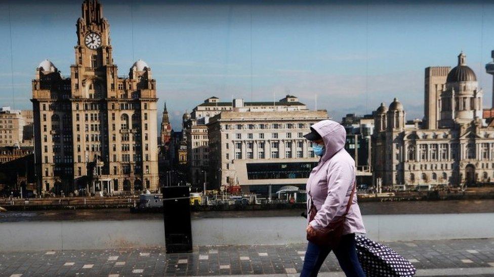 Woman wearing mask walking in Liverpool