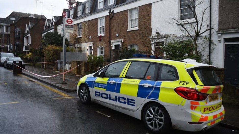 Police remained at the scene in Battersea Church Road