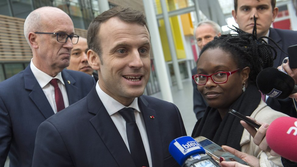French President Emmanuel Macron gives a press point next to his Public Relations advisor Sibeth Ndiaye (R) during a visit at the Michelin Ladoux Research and Technology centre in Ladoux, central France, on January 25, 2018