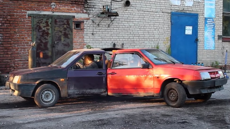 Three Russian cars welded together in an attempt to make a car-based fidget spinner