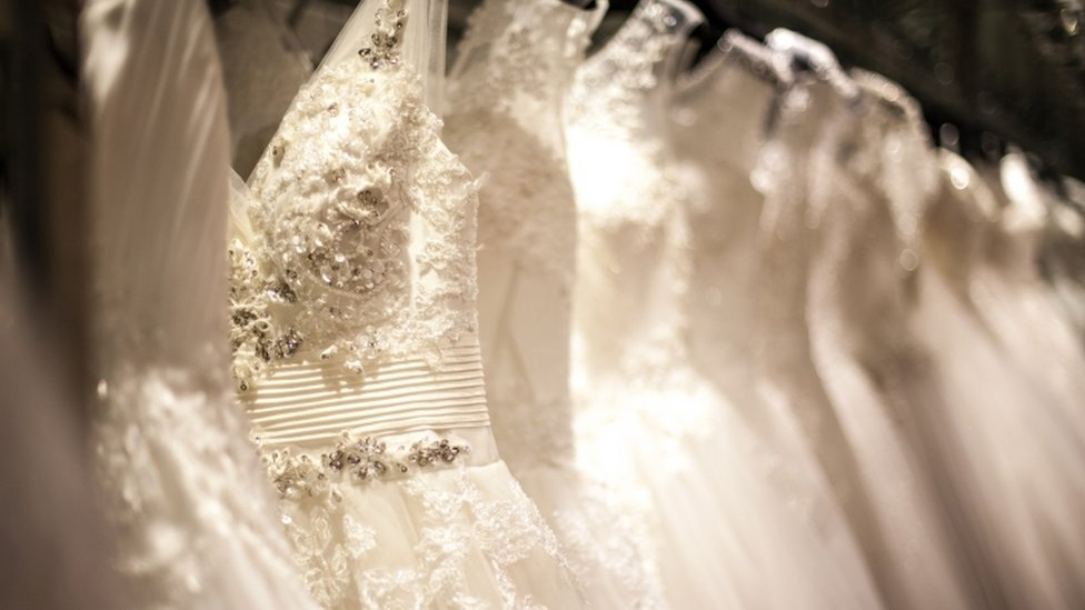 A close up image of a wedding dress