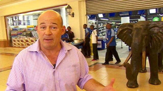 BBC Africa Correspondent Alastair Leithead outside the newly refurbished Nakumatt supermarket