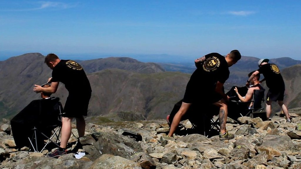 Cumbrian barbers climb Scafell Pike for charity trims
