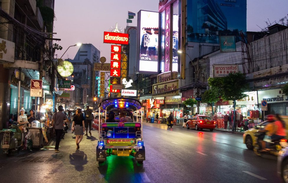 Picture of a Thai street lined with hawkers in Bangkok