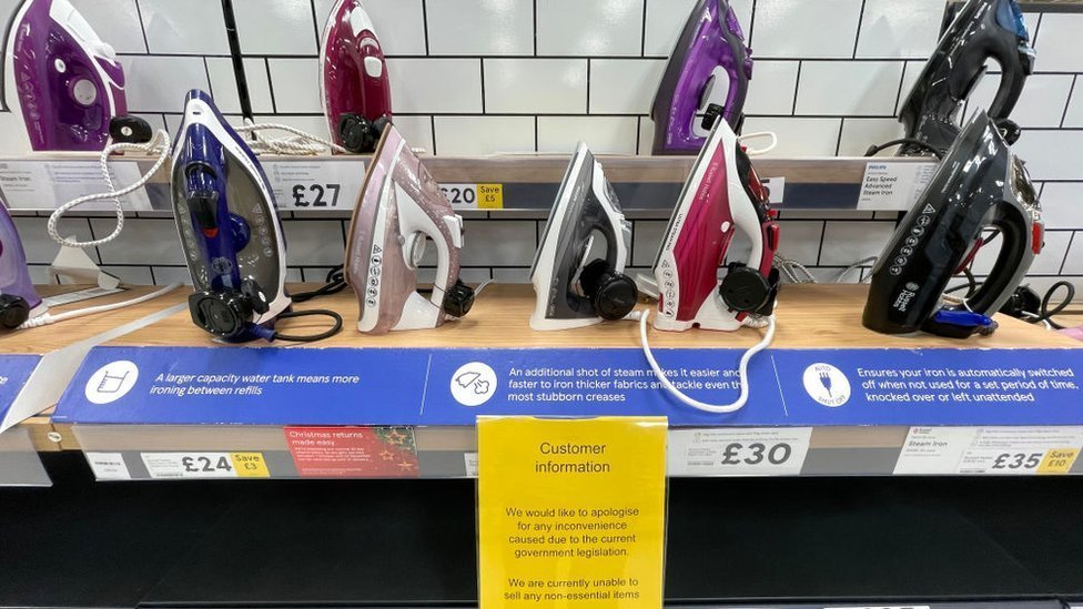 Items deemed non-essential covered up in a Tesco store in Cardiff