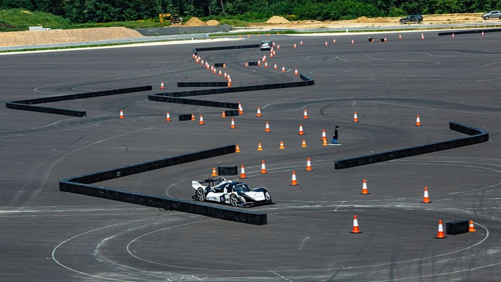 Roborace cars on obstacle course
