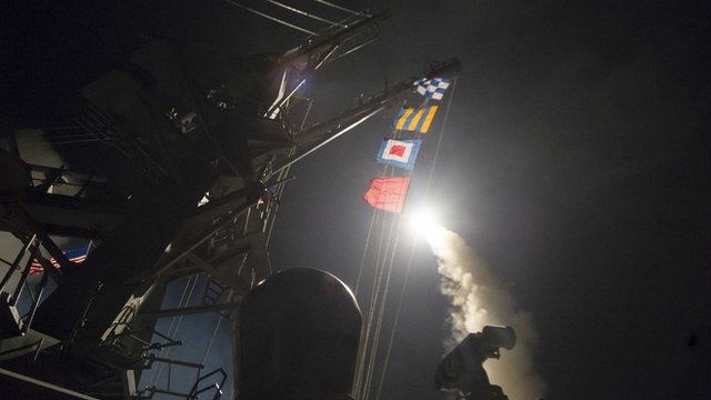 USS Ross fires a tomahawk missile, at a Syrian air force base