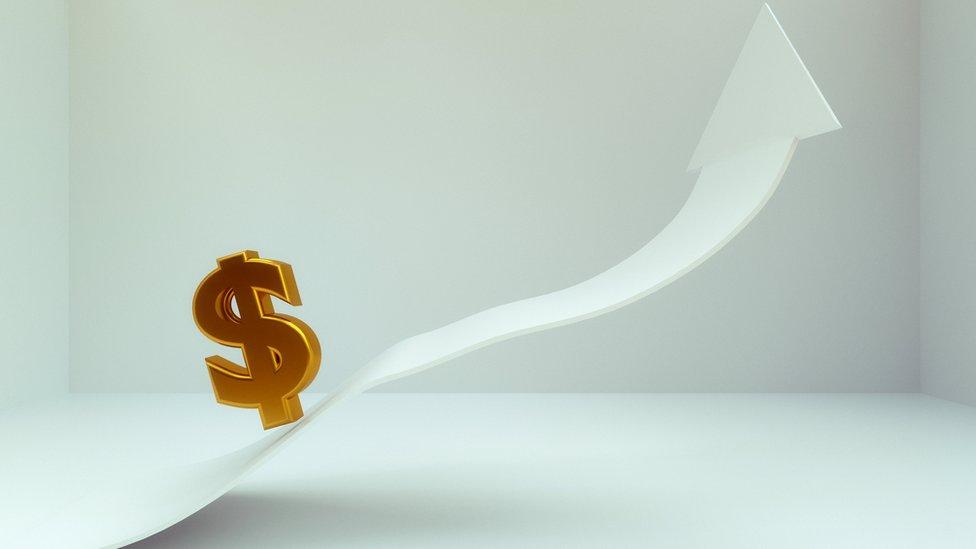 Imagen gráfica con el símbolo de dólar con una flecha ascendente