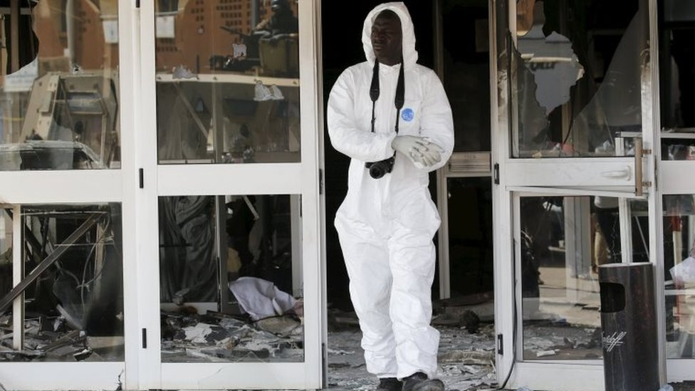 A forensic police officer exits the Splendid Hotel after al Qaeda militants killed at least 28 people from at least seven countries in an attack on the hotel and a restaurant in Ouagadougou, Burkina Faso, January 18, 2016.