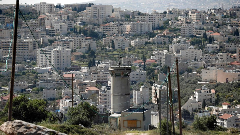 A picture taken from a settlement in east Jerusalem shows an Israeli army watchtower overlooking the Palestinian town of Beit Jala