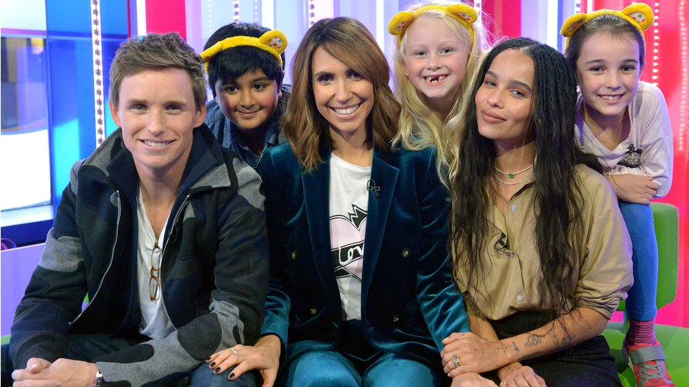 Eddie Redmayne and Zoe Kravitz played a joke on The One Show presenter Alex Jones with the help of (left to right) Vidhit Nihal, 8, Kelsey Wheatley, 7, and Lucy Subbiah, 9 during The One Show for BBC Children in Need
