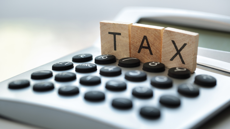 Tax and calculator graphic