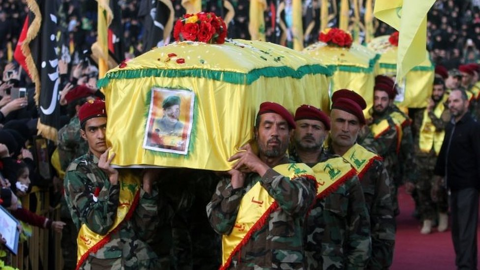 Hezbollah fighters in Nabatiyeh, Lebanon, carry the Hezbollah flag-draped coffins of Shia fighter killed in Syria supporting Syrian government forces (27 October 2015)
