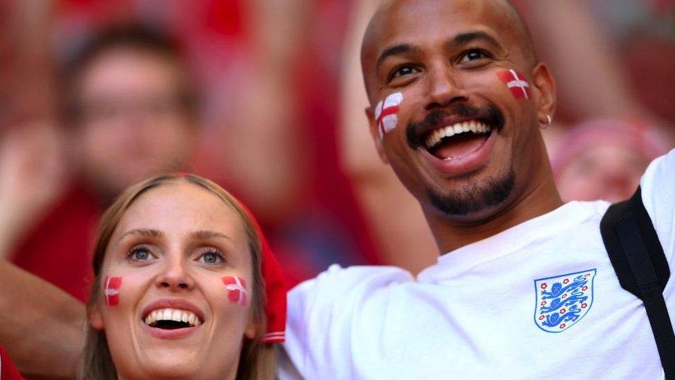 A Danish fan and England fan
