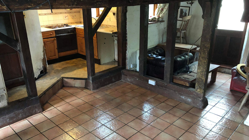 The kitchen and downstairs area after it was cleared and cleaned