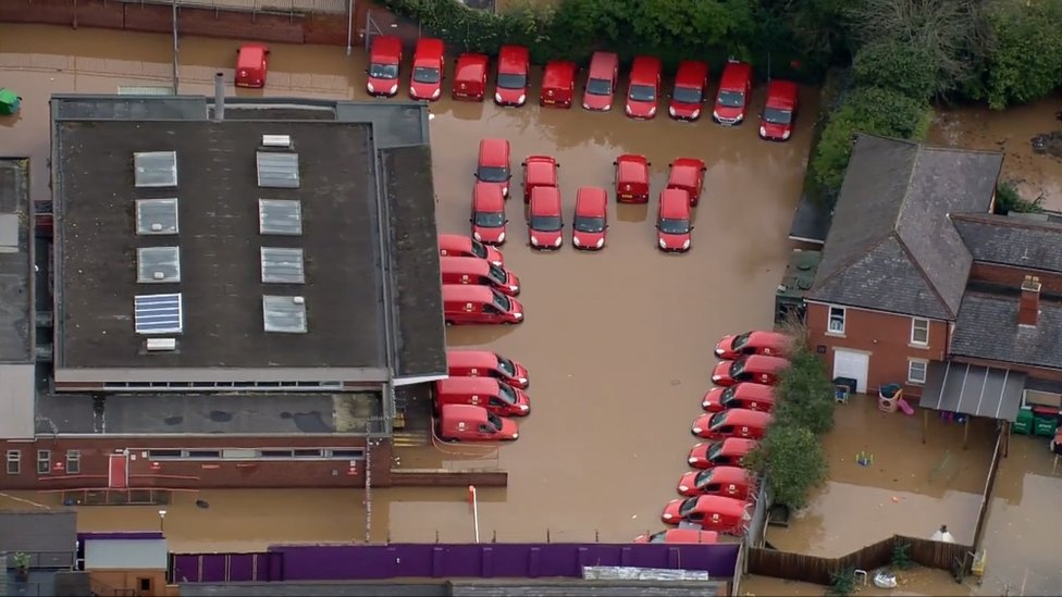 Royal Mail vans in flood water