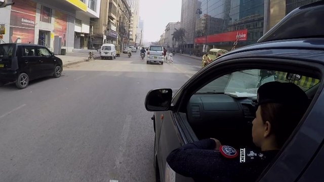 Syeda Ghazala in a police car