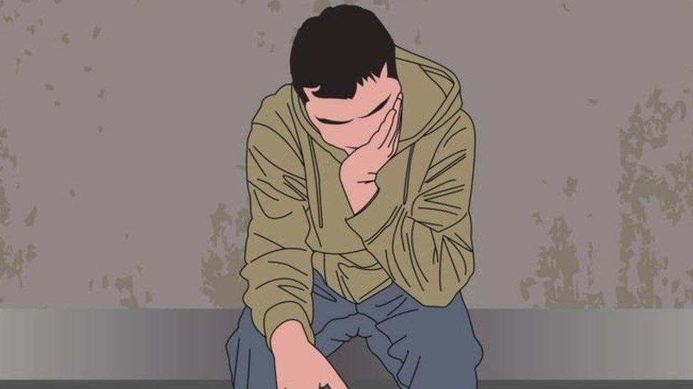 Un dibujo de un hombre sentado