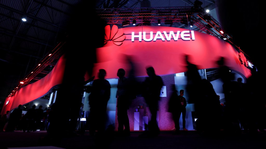 "Visitors walk past Huawei""s booth during Mobile World Congress in Barcelona, Spain, February 27, 2017. REUTERS/Eric Gaillard/File Photo"
