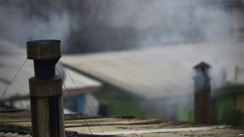 Smokestacks pollute the air in a neighbourhood of Temuco, Chile on 19 June, 2015.