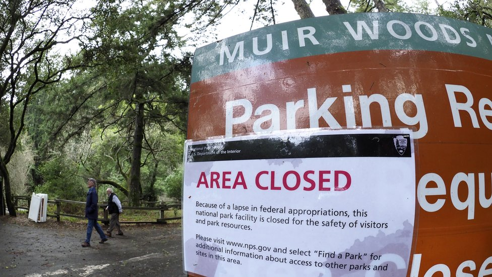 Hikers walk out of a closed Muir Woods National Monument, part of California's Golden Gate National Recreation Area,