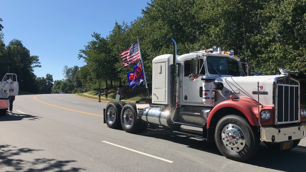 Truck with flags driving along a road in Virginia