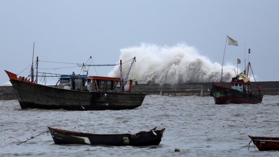 Waves crash against the jetty at a fishing harbour ahead of the expected landfall of Cyclone Vayu at Veraval, India, June 12, 2019