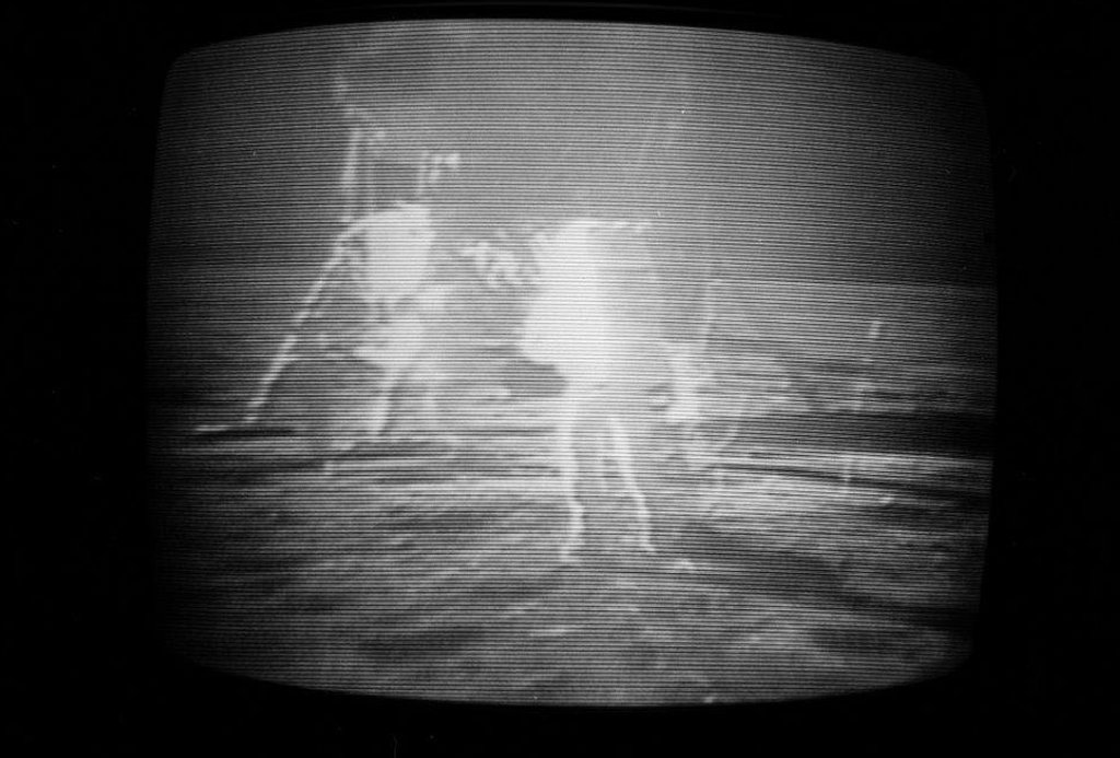 Blurry TV image of the astronauts on the surface of the Moon