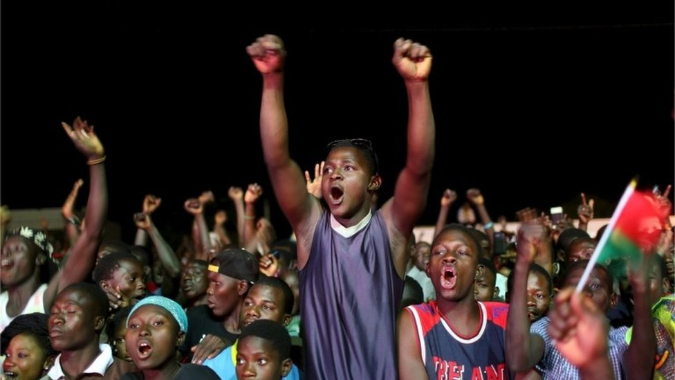 Supporters of President-elect Roch Marc Kabore cheer at Kabore's campaign headquarters in Ouagadougou, December 1, 2015