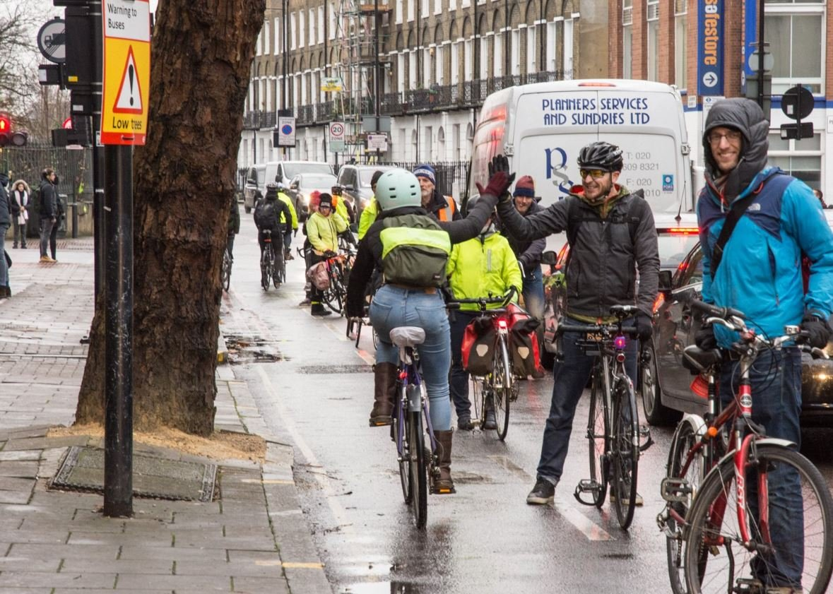 Cyclists form a line to protect a cycle lane in Penton Street, London, 13 December 2017