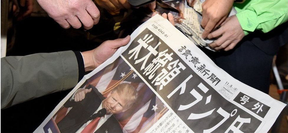 Japanese newspaper showing a headline about Trump's win.