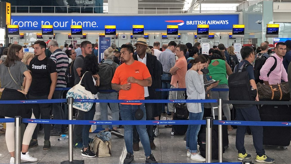 """Queues in Terminal 5 at Heathrow airport as the UK""""s biggest airport has apologised after extreme weather conditions across Europe caused flight cancellations and delays."""