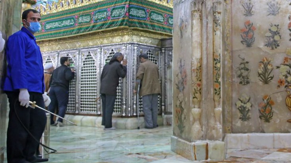 Iranian sanitary workers disinfect Qom's Masumeh shrine